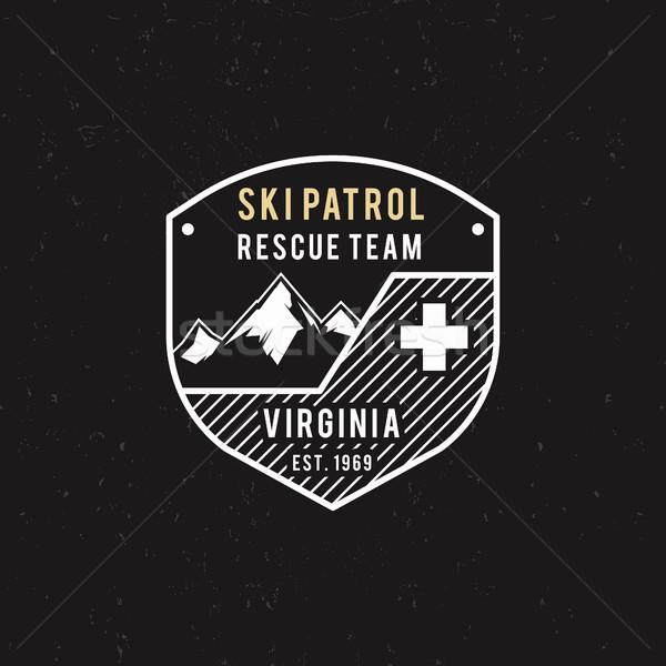 Winter ski patrol, rescue team label with mountains. Vintage extreme adventure badge. Outdoors logo  Stock photo © JeksonGraphics