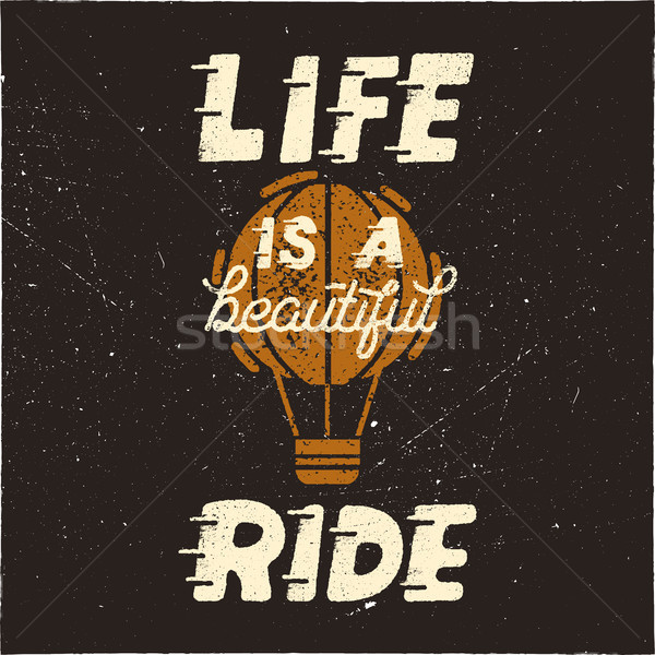 Life is a beautiful ride. Vintage hand drawn typography design poster with hot balloon in retro dist Stock photo © JeksonGraphics