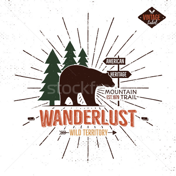 Vintage hand drawn Wanderlust emblem with bear, forest and sunbursts elements. Travel badge for prin Stock photo © JeksonGraphics