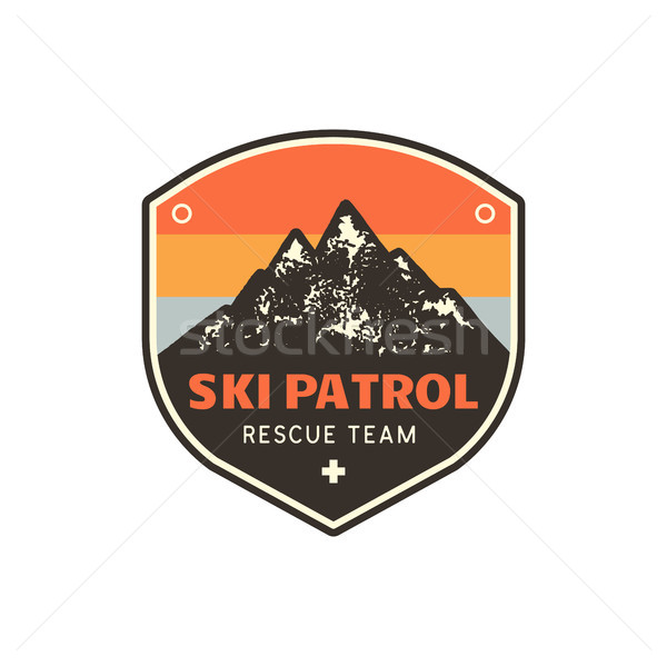 Vintage hand drawn mountain ski patrol emblem. Rescue team patch. Mountains stamp. Retro colors, gru Stock photo © JeksonGraphics