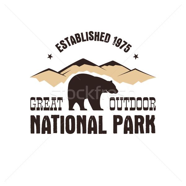 National park retro style badge. Mountain explorer label. Outdoor adventure logo with bear. Travel a Stock photo © JeksonGraphics