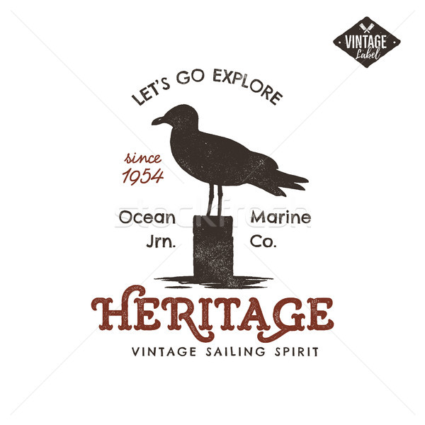 Vintage hand drawn label design. Seagull symbol. Letterpress effect. Typography insignia, t-shirt ap Stock photo © JeksonGraphics