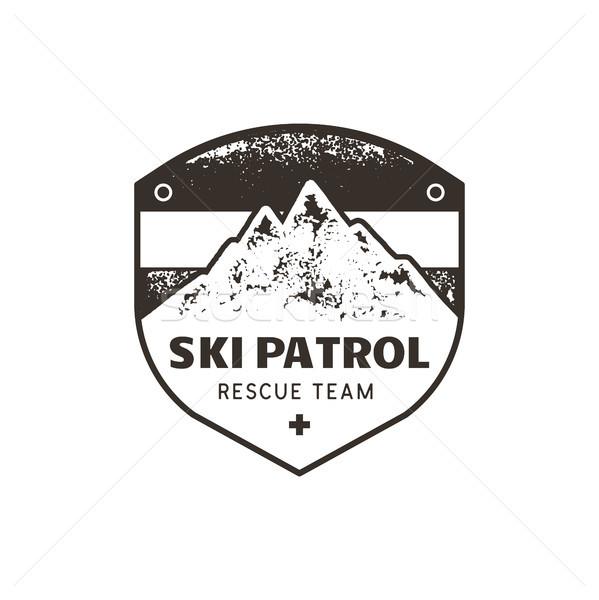Vintage hand drawn mountain ski patrol emblem. Rescue team patch. Mountains stamp. Monochrome, grung Stock photo © JeksonGraphics