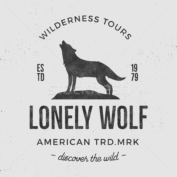Old wilderness label with wolf and typography elements. Vintage style wolf logo. Prints of howling w Stock photo © JeksonGraphics