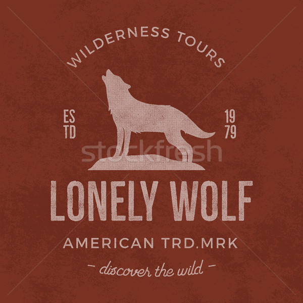 Old wilderness label with wolf and typography elements. Vintage style wolf logo. Print of howling wo Stock photo © JeksonGraphics