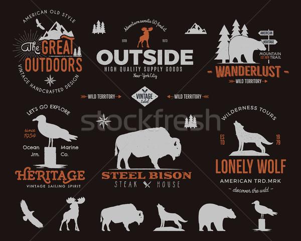Wild animal badges set and outdoors activity insignias. Retro illustration of animal badges. Typogra Stock photo © JeksonGraphics