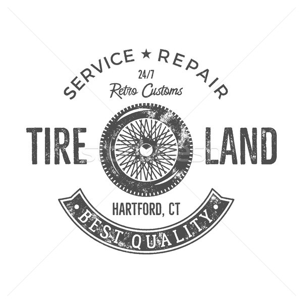 Vintage tire service label design. Retro emblem in monochrome style with old wheel and typography el Stock photo © JeksonGraphics