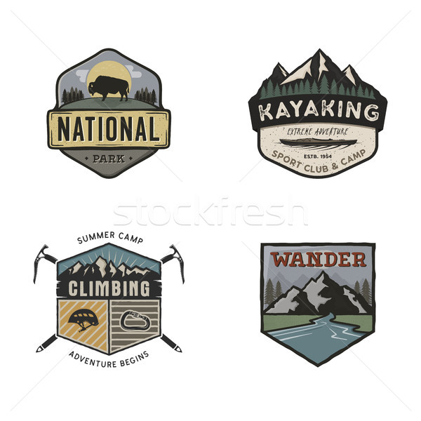 Stock photo: Set of vintage hand drawn travel logos. Camping labels concepts. Mountain expedition badge designs.