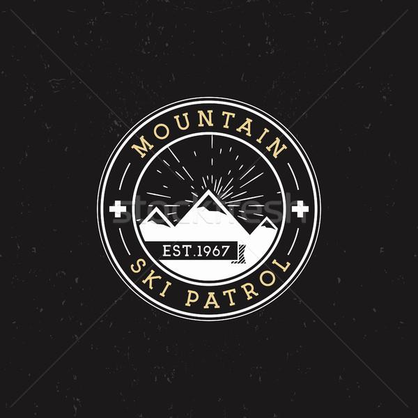 Camping Label. Vintage Mountain ski patrol round patch. Outdoor adventure logo design. Travel retro  Stock photo © JeksonGraphics