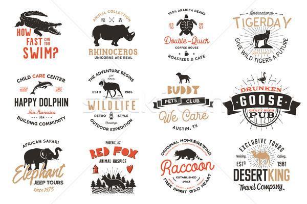 Wild animal Badges set and great outdoors activity insignias. Retro illustration of animal badges. T Stock photo © JeksonGraphics