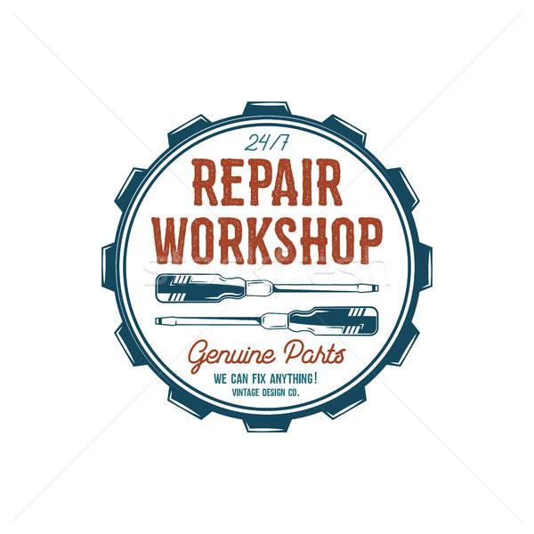 Vintage label design. Repair workshop emblem in retro colors style with garage tools - screwdrivers  Stock photo © JeksonGraphics