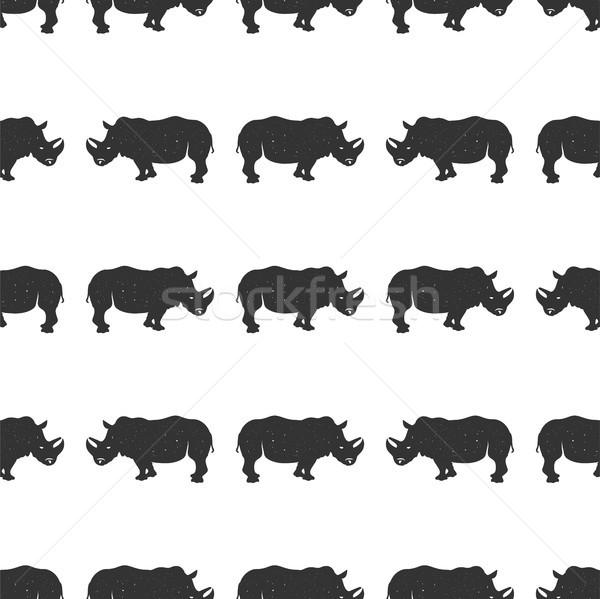 Rhino seamless. Wild animal wallpaper. Stock rhinoceros pattern isolated on white background. Monoch Stock photo © JeksonGraphics