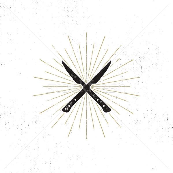 meat cleaver and knife symbols. Vintage steak house symbol. Letterpress effect with sunbursts. desig Stock photo © JeksonGraphics