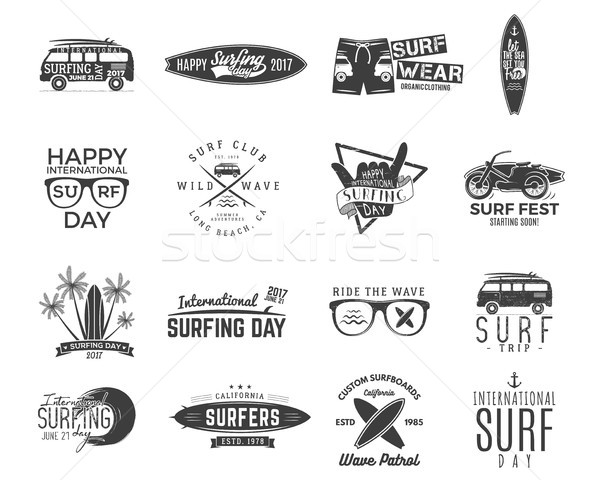 Vintage surfing graphics and emblems set for web design or print. Surfer, beach style logo design. S Stock photo © JeksonGraphics