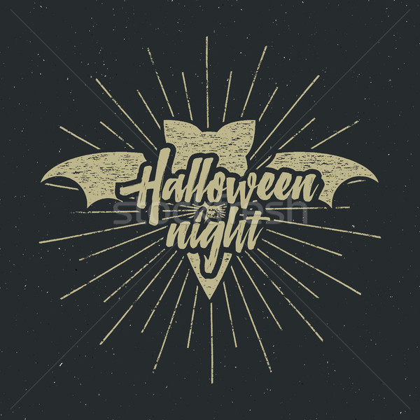 Halloween party night label template with bat, sun bursts and typography elements on dark background Stock photo © JeksonGraphics