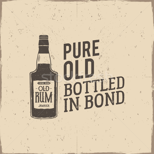 Vintage handcrafted label, emblem with old rum bottle and slogan - pure old bottled in bond. Sketchi Stock photo © JeksonGraphics