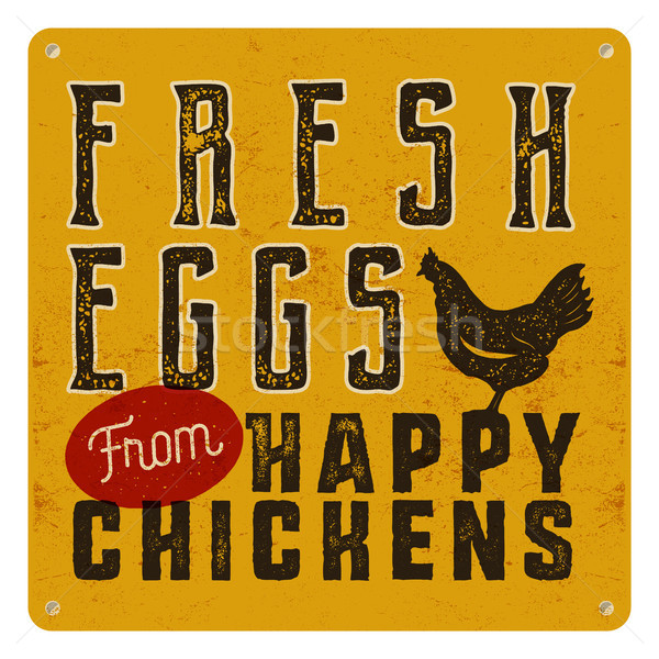 Farm fresh eggs poster on yellow vintage rusty metal background with chicken. Retro typography style Stock photo © JeksonGraphics