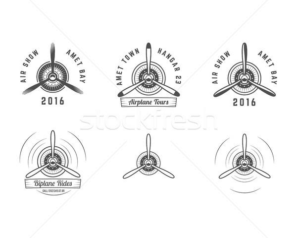 Set of Vintage airplane propeller emblems. Biplane labels. Retro Plane badges,design elements. Aviat Stock photo © JeksonGraphics
