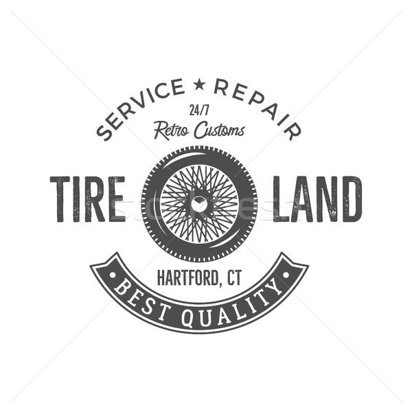 Vintage label design. Tire service emblem in monochrome retro style with old wheel and typography el Stock photo © JeksonGraphics