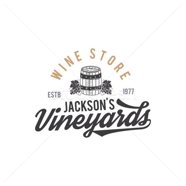 Wine shop logo, label. Organic wines.Vineyard badge. Retro Drink symbol - wine barrel, vines. Monoch Stock photo © JeksonGraphics
