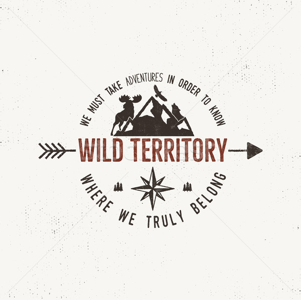 Vintage wild emblem. Retro illustration of wilderness . Typography and rough style. Vector  logo or  Stock photo © JeksonGraphics