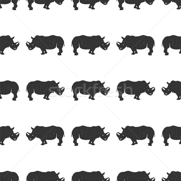 Rhino seamless. Wild animal wallpaper. Stock vector rhinoceros pattern isolated on white background. Stock photo © JeksonGraphics