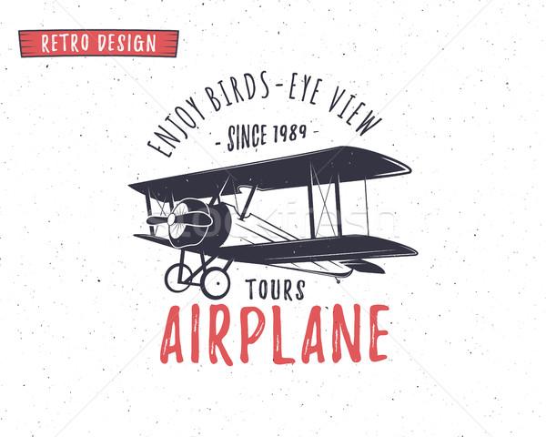 Repülőgép embléma kétfedelű repülőgép címke retro repülőgép Stock fotó © JeksonGraphics