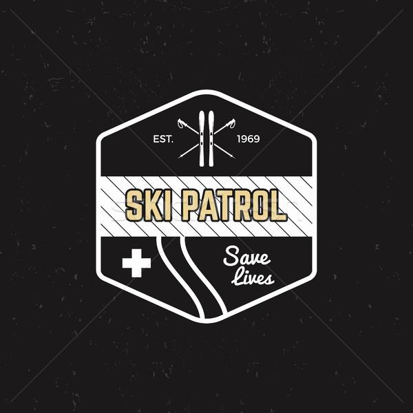 Ski patrol patch. Vintage outdoor design with mountain winter rescue gear. Outdoor adventure logo de Stock photo © JeksonGraphics
