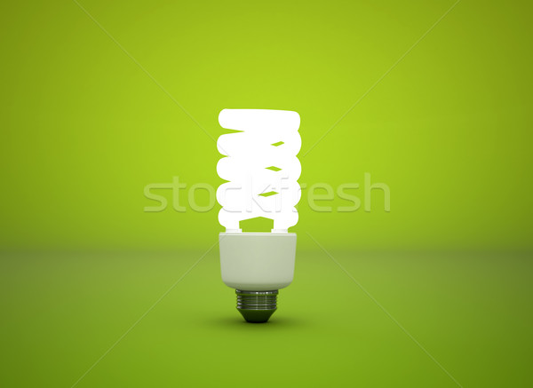 Compact fluorescent light bulb green background Stock photo © jezper