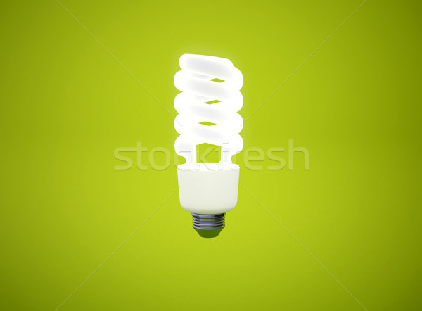 energy saving light bulb on green background  Stock photo © jezper