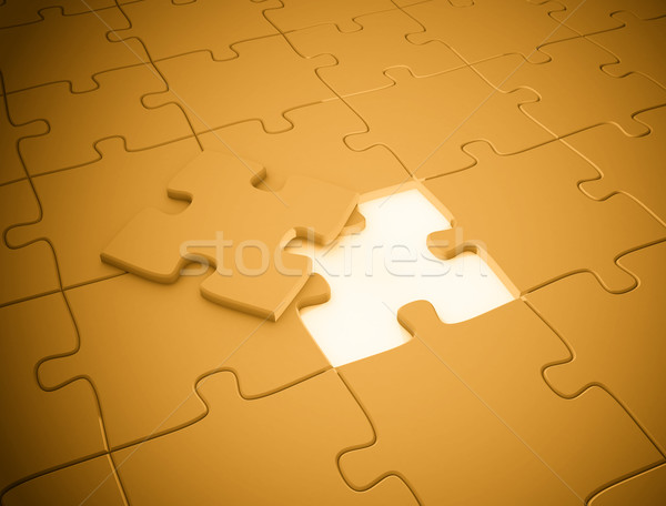 Stock photo: Last piece of the puzzle orange golden glow