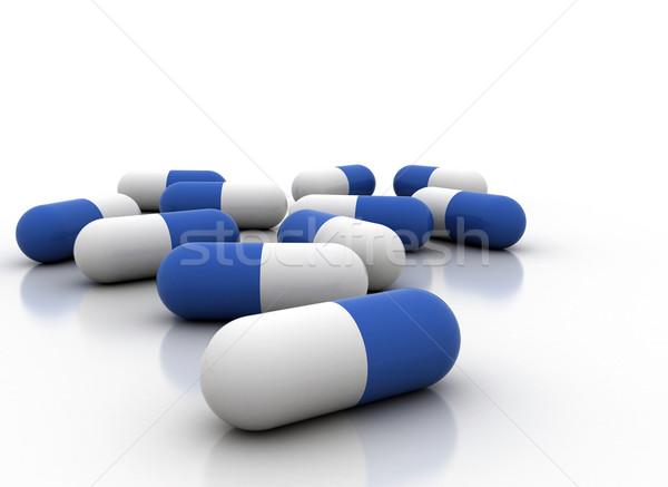 Tabletták kék fehér tabletta konténer gyógyszertár Stock fotó © jezper