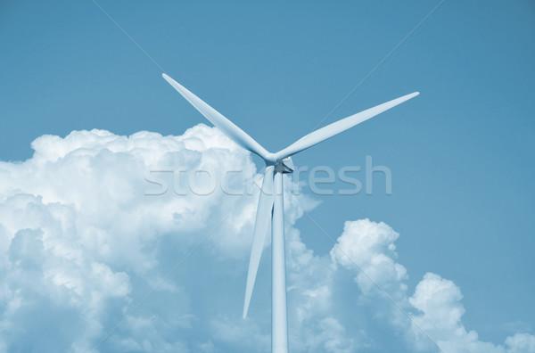 Wind turbine clouds and blue sky  Stock photo © jezper