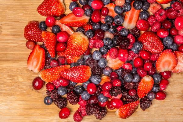 Stock photo: Berries on Cutting Board