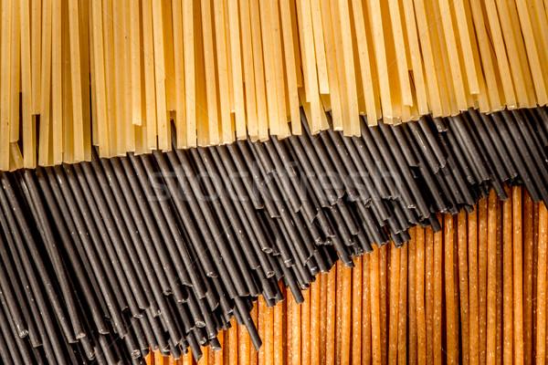 Three different colours of raw spaghetti Stock photo © JFJacobsz