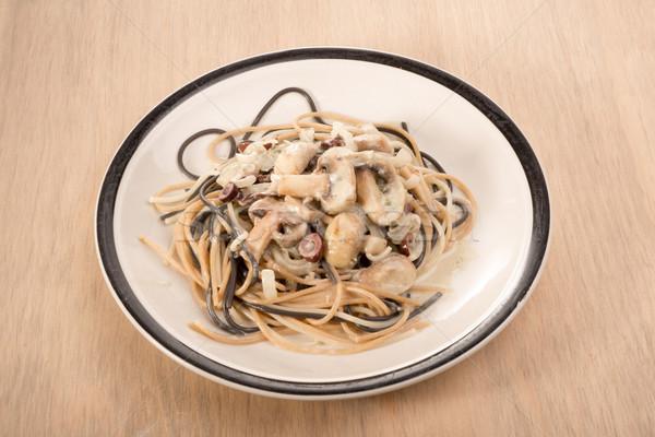Piatto spaghetti mista bianco funghi oliva Foto d'archivio © JFJacobsz
