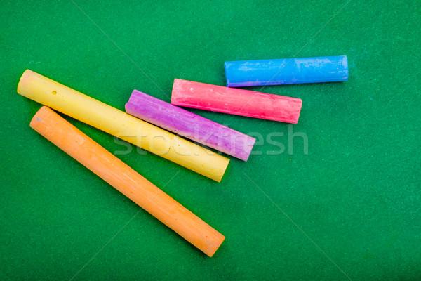 Five stick of Chalk on Green Stock photo © JFJacobsz