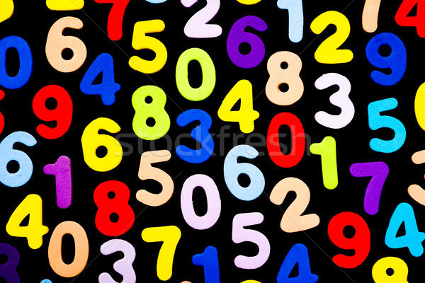 Brightly coloured numbers on black background Stock photo © JFJacobsz