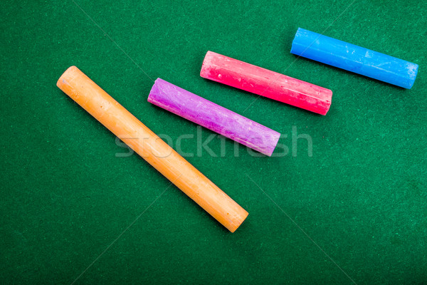 Four pieces of chalk on green Stock photo © JFJacobsz