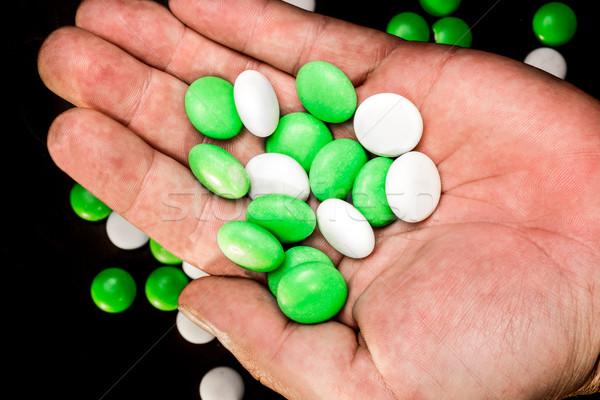 Mints in a hand's palm Stock photo © JFJacobsz