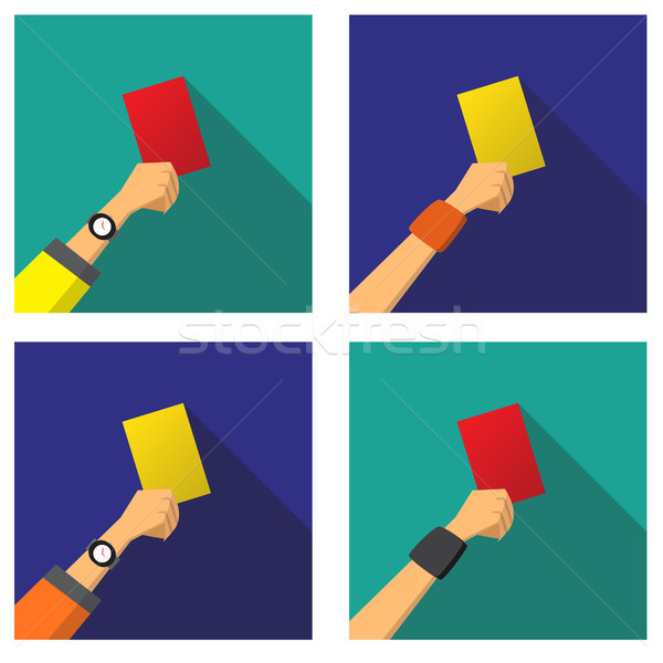 Hand with a red and yellow card of football Stock photo © jiaking1