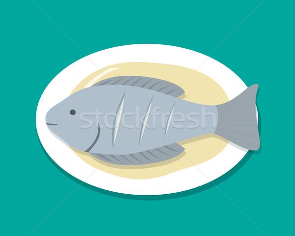 Felső kilátás párolt hal fehér tányér Stock fotó © jiaking1