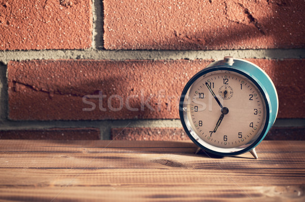 old clock in front of a brick wall Stock photo © jirkaejc