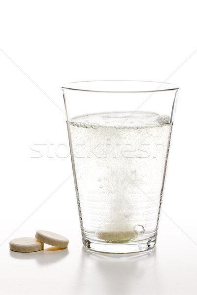 effervescent tablets and glass with water Stock photo © jirkaejc