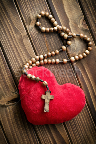 furry heart with rosary beads Stock photo © jirkaejc