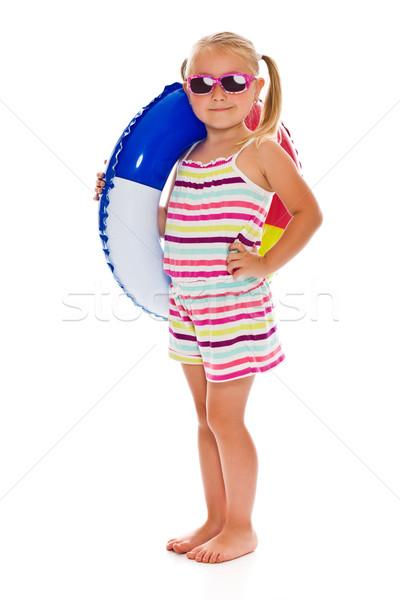 Dziewczynka okulary nadmuchiwane pierścień biały plaży Zdjęcia stock © jirkaejc