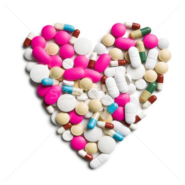 heart of colorful pills Stock photo © jirkaejc