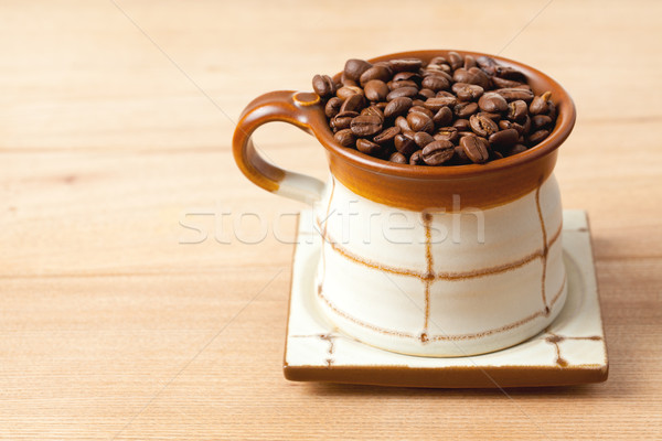 coffee beans in ceramic cup Stock photo © jirkaejc