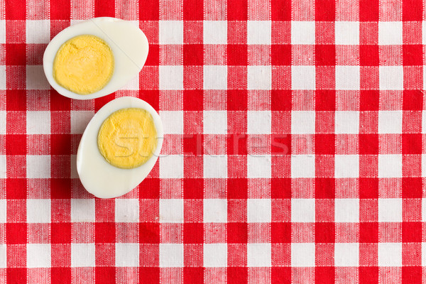 two halves of a boiled egg Stock photo © jirkaejc