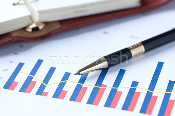 financial graph and pen Stock photo © jirkaejc